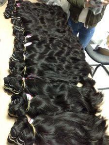 VIETNAM REMY HAIR MACHINE WEFT NATURAL WAVY COLOR 1B