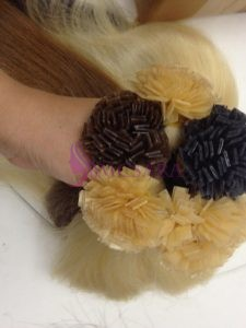 Flat tip straight hair extensions black, blond and brown color